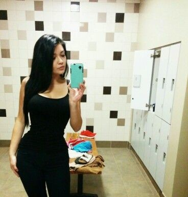 woman wearing a waist trainer from amazon underneath her clothes and showing off her results in a selfie